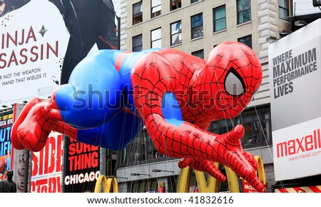 MANHATTAN - NOVEMBER 26 : Spiderman balloon passing Times Square at the Macy's Thanksgiving Day Parade November 26, 2009 in Manhattan. - stock photo