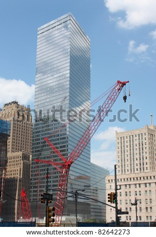 MANHATTAN, NY - AUG 5 : Construction crane at ground zero site where 2,752 died from terrorist acts of September 11, 2001 that destroyed the twin towers in downtown Manhattan New York, August 5, 2010 - stock photo