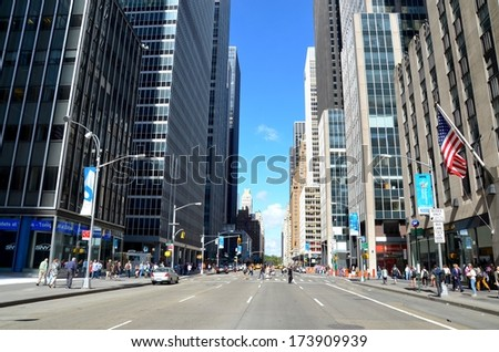 MANHATTAN, NY- SEPTEMBER 21: Manhattan streets, and Modern Architecture in New York, USA on September 21, 2013. One of the 5 boroughs of New York City, the smallest but also the most populated. - stock photo