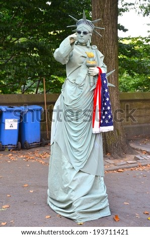 MANHATTAN, NY- SEPTEMBER 21: Person with a Statue of Liberty Costume in New York, USA on September 21, 2013. One of the 5 boroughs of New York City, the smallest but also the most populated. - stock photo