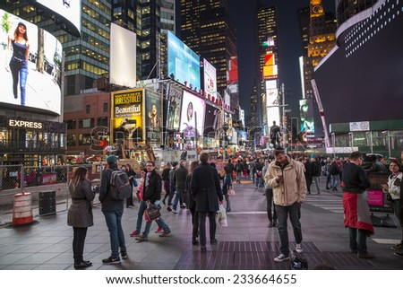 Manhattan, NYC - November 3: View of tourist packed Times Square by night, in Manhattan, NYC on November 3, 2014. - stock photo
