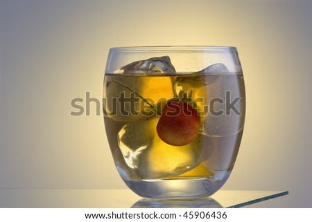 Manhattan or Rob Roy  mixed drink on ice - stock photo