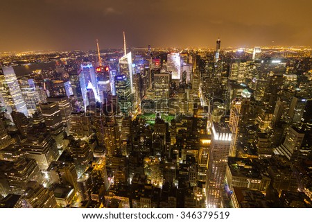 Manhattan overview at night from Empire State Building, NYC - stock photo