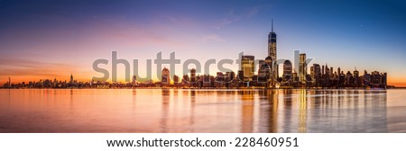 Manhattan panorama at sunrise, as viewed from Jersey City across the Hudson river - stock photo