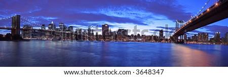 Manhattan panoramic- Brooklyn and Manhattan Bridge at twilight (very large and detailed file) - stock photo