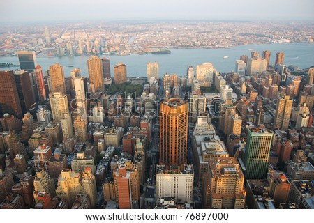 Manhattan Skyline aerial view east and Brooklyn, viewed from Empire State Building. - stock photo