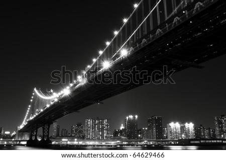 Manhattan Skyline and Manhattan Bridge At Night, New York City - stock photo