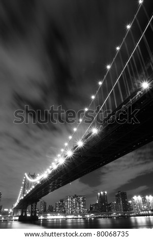 Manhattan Skyline and Manhattan Bridge At Night, New York City - stock photo