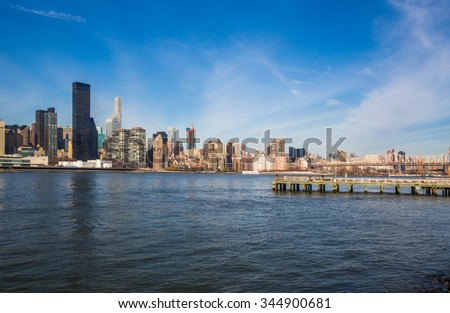 Manhattan skyline and Queensboro bridge. - stock photo