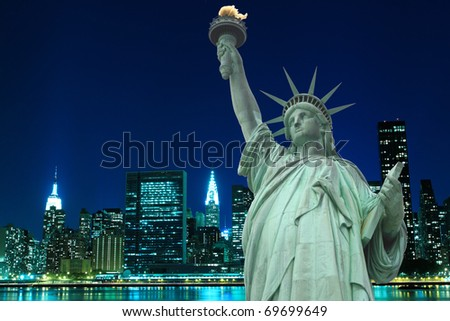 Manhattan Skyline and The Statue of Liberty at Night Lights, New York City