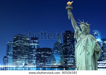 Manhattan Skyline and The Statue of Liberty at Night Lights, New York City - stock photo