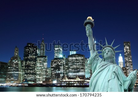 Manhattan Skyline and The Statue of Liberty at Night, New York City