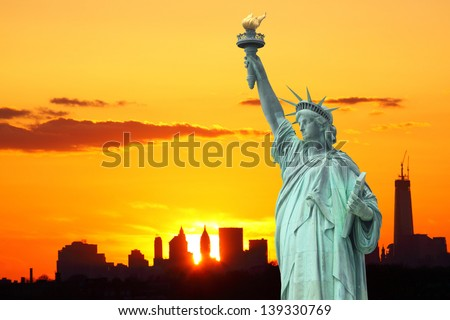 Manhattan Skyline and The Statue of Liberty at Sunset, New York City