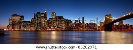 Manhattan skyline at night, New York City, NY.  Shot in 2005.  This is a high resolution seamless stitch of three 12MP images.