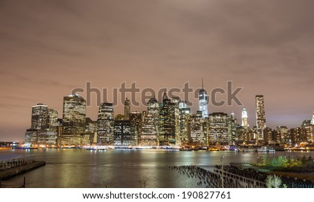 Manhattan skyline by night - stock photo
