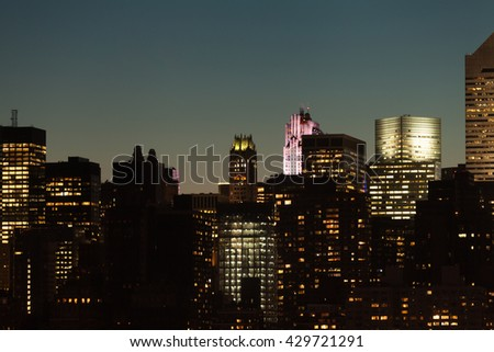 Manhattan skyline detail with skyscrapers during twilight in New York City, USA. - stock photo