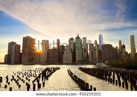 Manhattan skyline from Brooklyn Bridge Park at sunset, New York - stock photo
