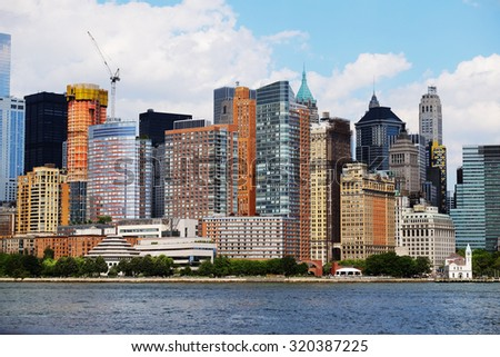 Manhattan skyline over Hudson River, New York, USA. Top of the big buildings in financial district, downtown panorama, NYC. Business background. NY skyscrapers. - stock photo
