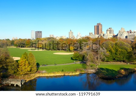 Manhattan skyline over Turtle Pond in Central Park, New York - stock photo