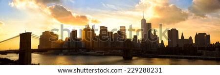 Manhattan skyline panorama with Brooklyn Bridge at sunset, New York City - stock photo