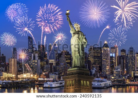 Manhattan Skyline, The Statue of Liberty fireworks at Night, New York City - stock photo
