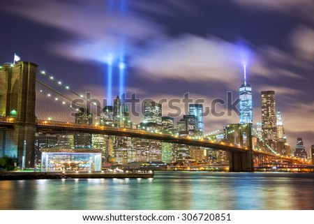 Manhattan skyline with Brooklyn Bridge and the Towers of Lights (Tribute in Light) in New York City - stock photo