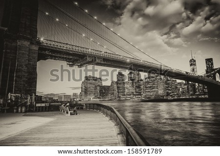 Manhattan skyline with East river reflections at night. - stock photo