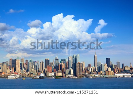Manhattan skyline with Empire State Building over Hudson River, New York - stock photo