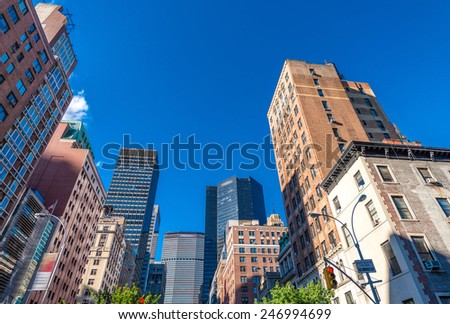 Manhattan skyscrapers with city trees, New York. - stock photo