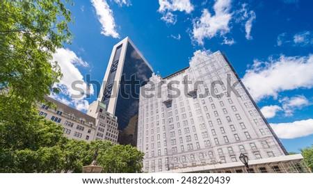 Manhattan skyscrapers with city trees, New York. - stock photo