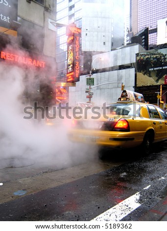 Manhattan street scene with steam coming from manhole cover - stock photo