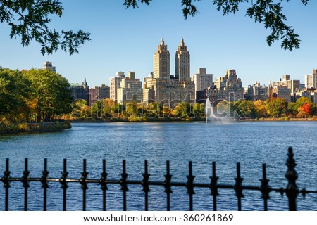 Manhattan Upper West Side with colorful fall foliage and fountain across Jacqueline Kennedy Onassis Reservoir. Central Park West . New York City. - stock photo