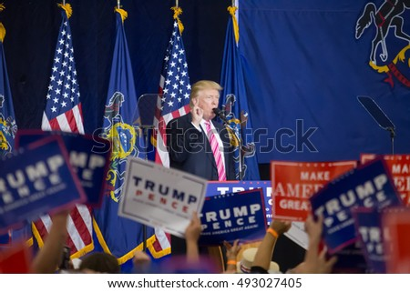 Manheim, PA - October 1, 2016: The oversized crowd waves signs as Donald J. Trump speaks at his campaign political rally Lancaster County.