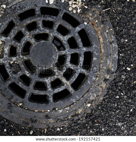 Manhole cover composition as a background texture - stock photo