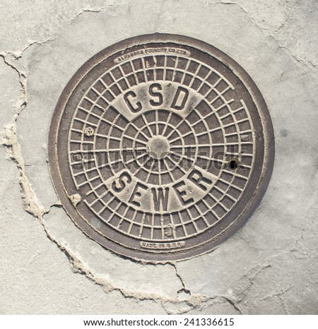 Manhole cover in Beverly Hills, CA. - stock photo