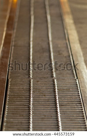 Manhole cover metal, rustic square manhole drain cover in the street, Steel Grill Sewer Cover or Manhole cover. - stock photo