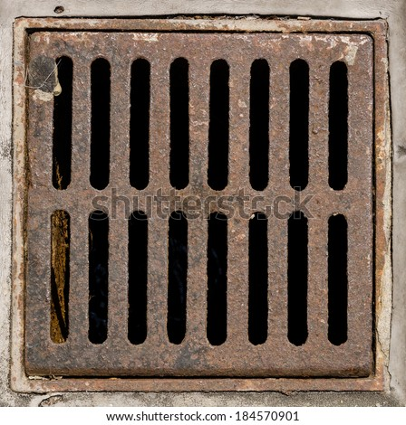 Manhole cover metal storm drain - stock photo