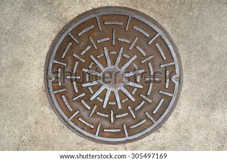 Manhole cover on street, top view. - stock photo