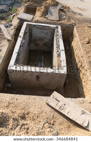 Manhole of drainage pipe under construction site - stock photo