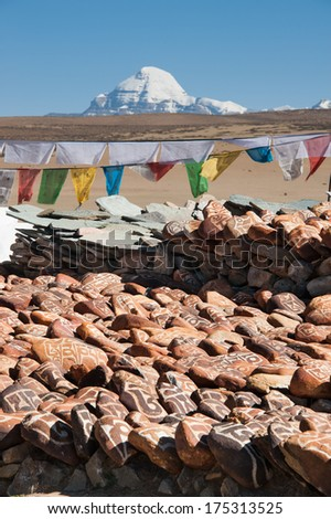 Mani stones at Chiu Gompa Monastery, with Mt.Kailash in background, Tibet.