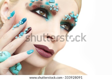 Manicure and makeup with turquoise stones at a young woman.