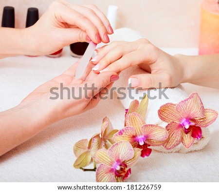 Manicure and pedicure and body care at spa. - stock photo