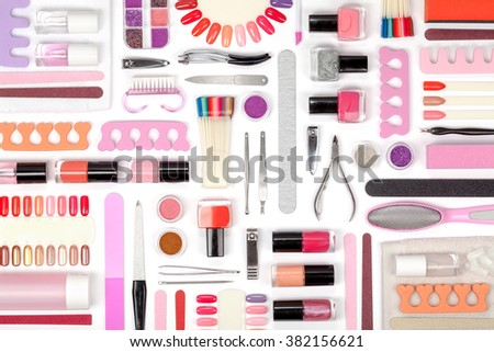 manicure and pedicure tools and other essentials on white background top view. flat lay composition in pink and orange colors - stock photo