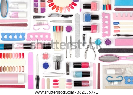 manicure and pedicure tools and other essentials on white background top view. flat lay composition in pink and blue colors - stock photo