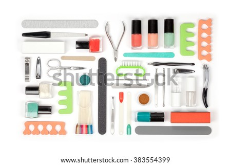manicure and pedicure tools and other essentials on white background top view. nail work flat lay concept in green and orange colors - stock photo