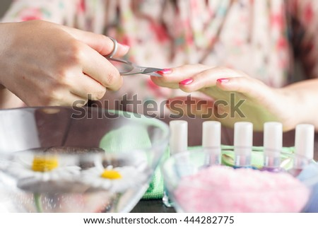 manicure applying, cutting the cuticle with scissors