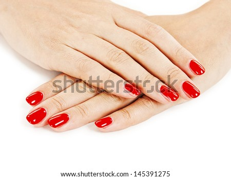 Manicure - Beautiful manicured woman's hands with red nail polish  - stock photo