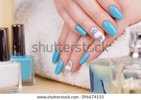 Manicure - Beauty treatment photo of nice manicured woman fingernails. Selective focus. - stock photo