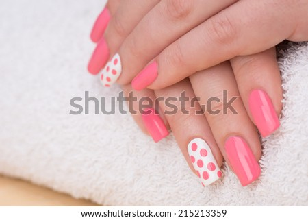 Manicure - Beauty treatment photo of nice manicured woman fingernails. Very nice feminine nail art with nice pink and white nail polish. Selective focus. - stock photo