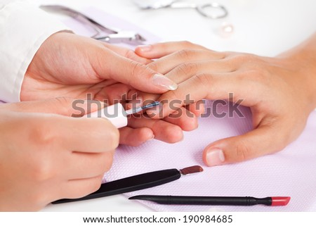 Manicure. Care of fingers of hands, cleaning, covering a varnish of nails. - stock photo